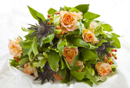 mariage: Bunch with different kind of flowers isolated on satin