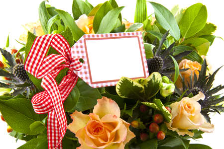 Bouquet with different kind of flowers with card on chequered red white ribbon photo