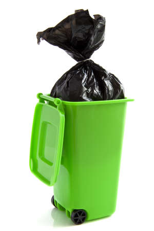 detritus: Green garbage box with plastic bag isolated over white