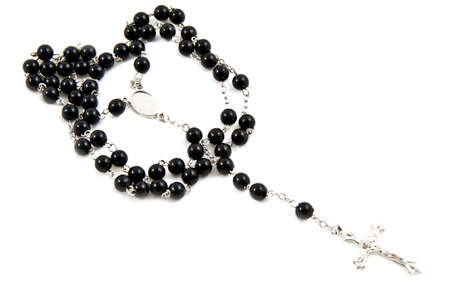 Rosary with black beads and silver cross isolated over white photo