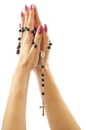 Hands with rosary isolated on a whita background