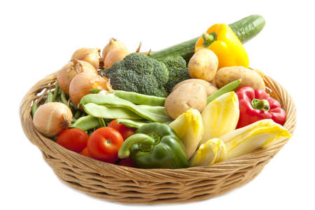 Lots of vegetables in a basket isolated over white photo
