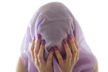 Girl with purple scarf covering her face Stock Photo