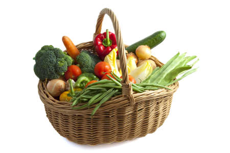Basket filled with lots of vegetables isolated over white