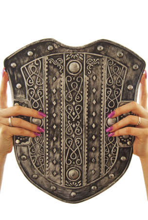 female hands holding old shield over white photo