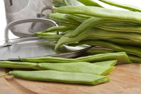 String beans on a board with cooking pan photo