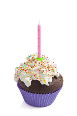 Decorated fresh birthday cupcake isolated over white photo
