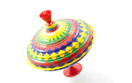 twirls: Vintage colorful spinning top isolated over white Stock Photo