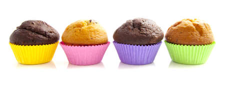 Muffins in a row isolated on a white background photo
