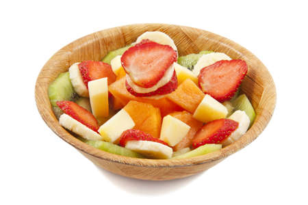 l nutrient: Different kind of fruit in a wooden bowl isolated over white Stock Photo