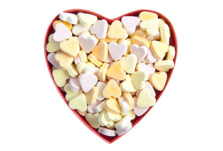 sweethearts: Heart gift box filled with candy sweethearts isolated over white Stock Photo
