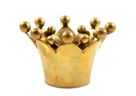 Golden crown close up isolated over white photo
