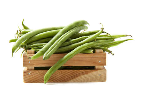 haricot vert: Green beans in a box isolated over white