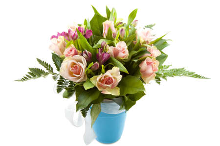 Bouquet with different kind of flowers in a blue vase isolated over white