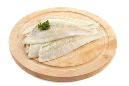 Plaice with parsley on wood isolated over white photo
