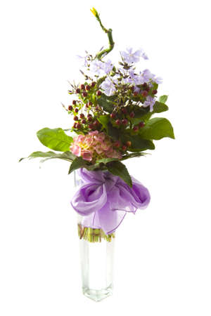 Bouquet with different kind of flowers in a vase isolated over white photo
