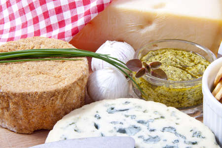 Different kind of cheese with pesto garlic and toast for background use photo