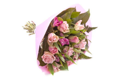 Bouquet with different kind of flowers wrapped in pink paper