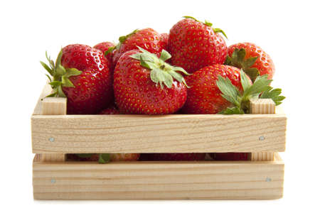 crate: Fresh strawberries in a wooden crate isolated over white