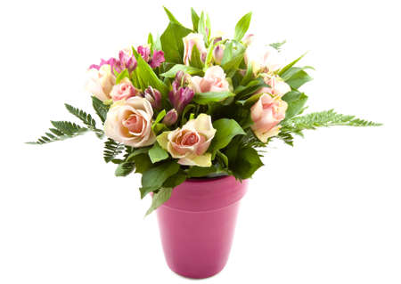bunch of red roses: Bouquet with different kind of colorful flowers in a pink vase