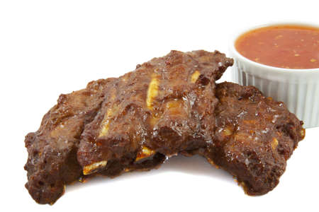 bbq ribs: Spareribs with hot sauce isolated over white