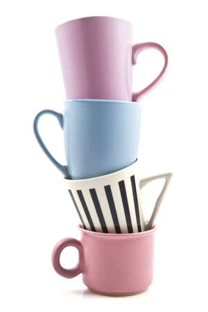 stacked: Four colored cups on a pile over white
