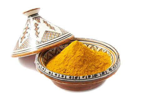 Tajine filled with spices isolated over white photo