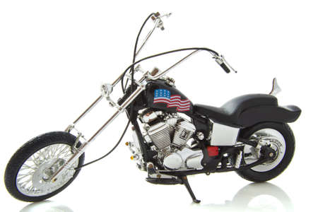 Motor cycle with american flag isolated over white photo