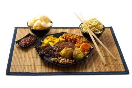 oriental cuisine: Indonesian food with chopsticks and noodles on a plate