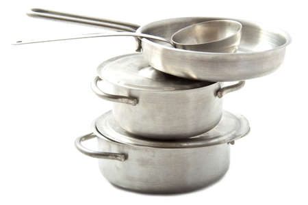 pots and pans: Stainless pots and pans on a pile