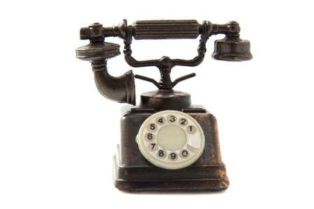 hablando por telefono: Tel�fono antiguo aislado en un fondo blanco