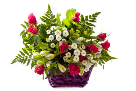 spotted flower: Beautiful bouquet with pink roses in a purple basket over white Stock Photo