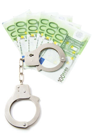 Hundred euro bills with handcuffs over white Stock Photo - 11108206