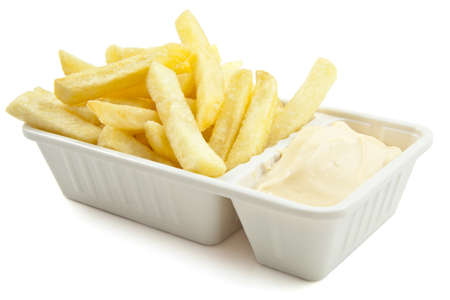 French fries with mayonaise on a white background Stock Photo
