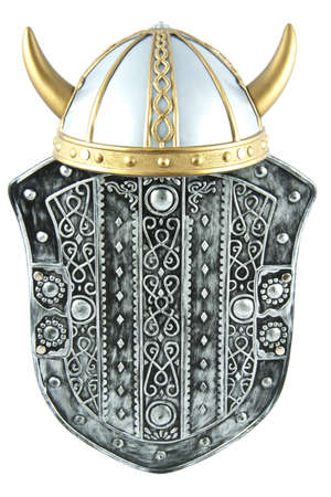 Old shield with old viking helmet isolated over white photo