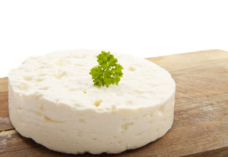 feta cheese: Feta on wood with parsley isolated over white Stock Photo