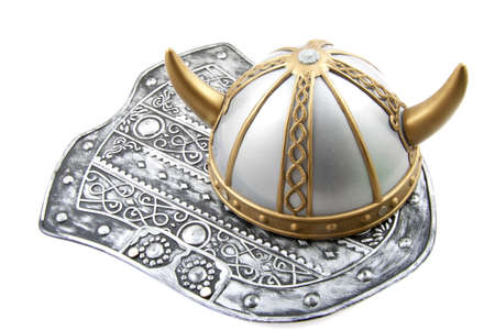 viking helmet: Old shield with old viking helmet on a white background