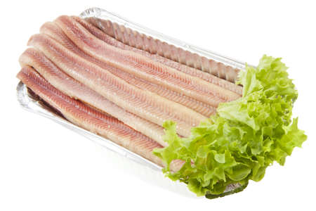 paling: Fresh paling in a aluminium box with salad over white