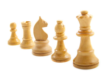White chess pieces in a row isolated