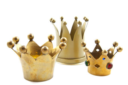 Three golden crowns on a white background