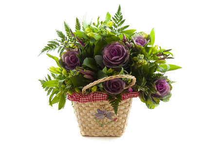 Basket with nice flowers isolated over white photo