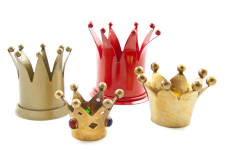 cupper: Four crowns in a row on a white background Stock Photo