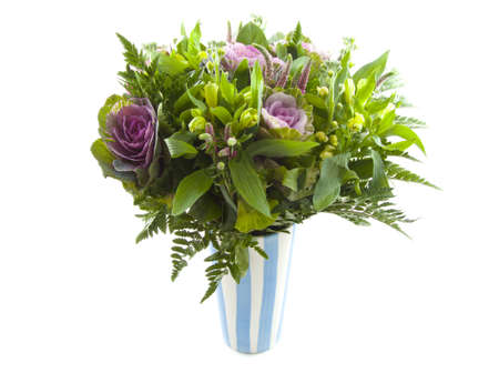 mariage: Bouquet with different kind of flowers in blue white vase over white