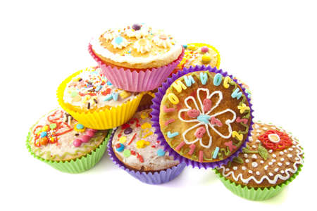Delicious colorful cupcakes on a pile over white Stock Photo - 11864467