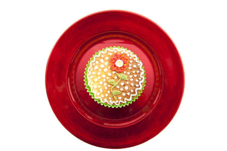 Delicious cupcake on a red shiny plate  over white photo