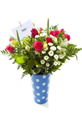 mariage: Bouquet with different kind of flowers in a blue spotted vase over white