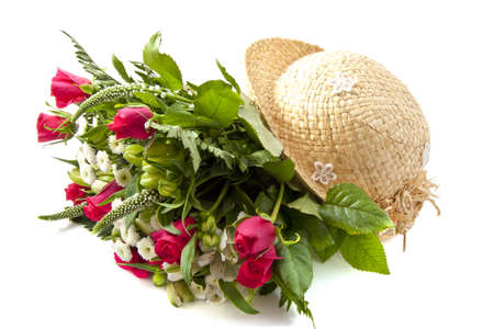 mariage: Colorful bouquet with straw hat over white