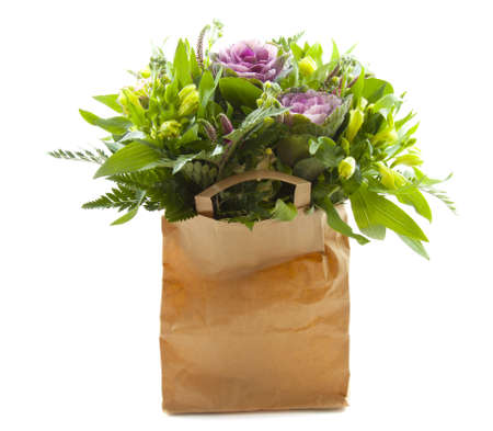 shoppingbag: Lovely bouquet in shopping-bag on a white background