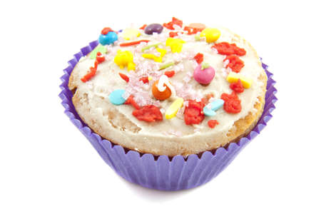 felicitation: Delicious fresh colorful cupcake close-up over white
