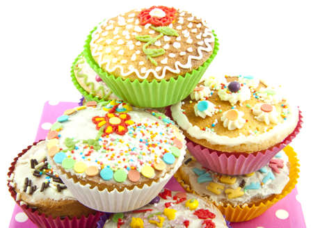 Delicious colorful cupcakes on a pile for background use photo